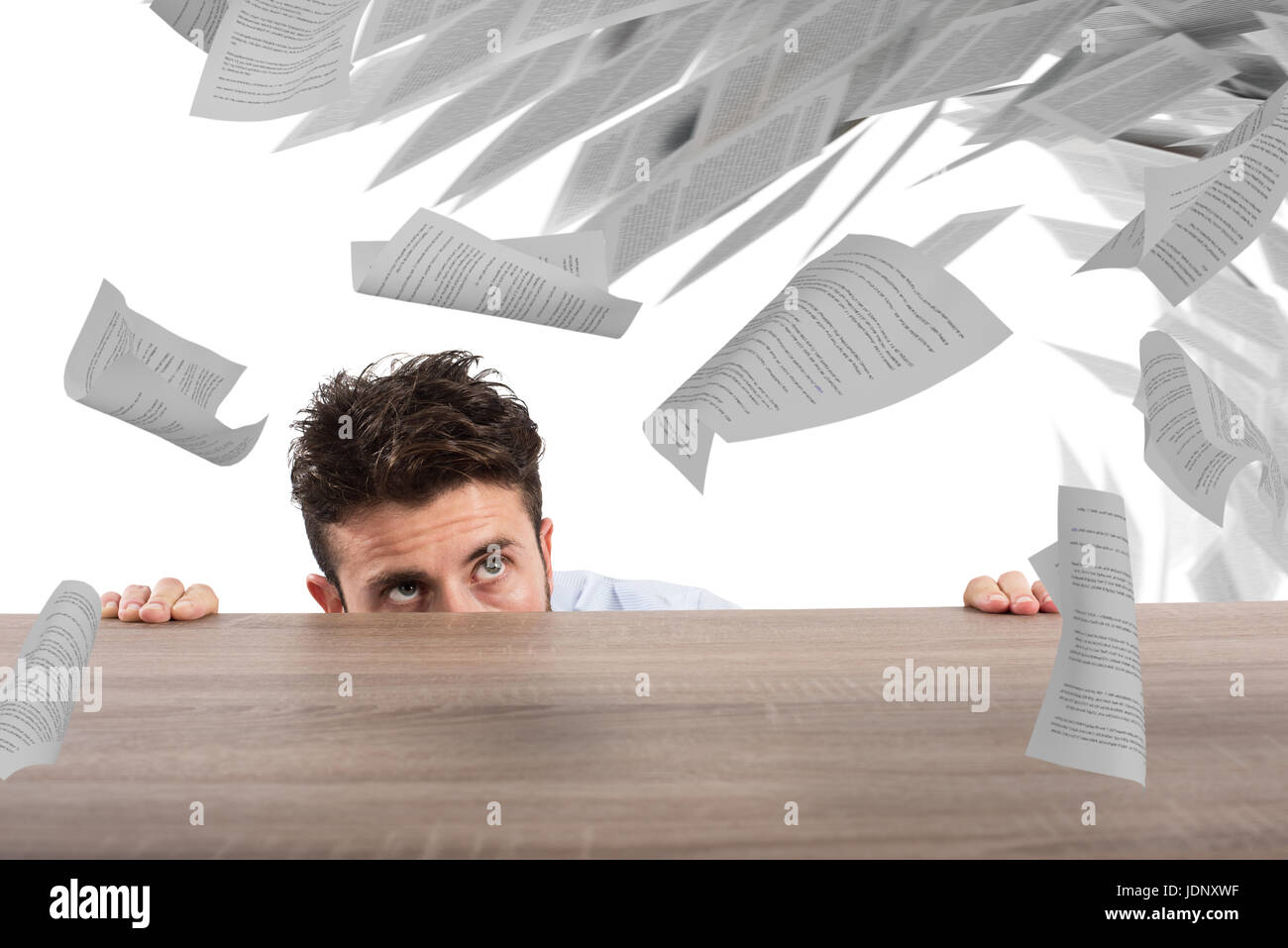 Businessman afraid under the desk. concept of overwork - Stock Image