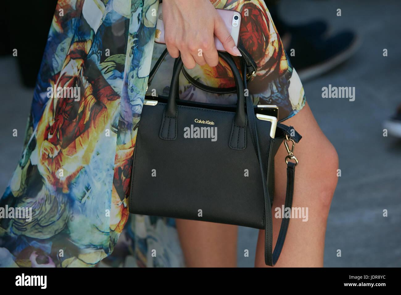 MILAN JUNE 19: Woman with black leather Calvin Klein bag