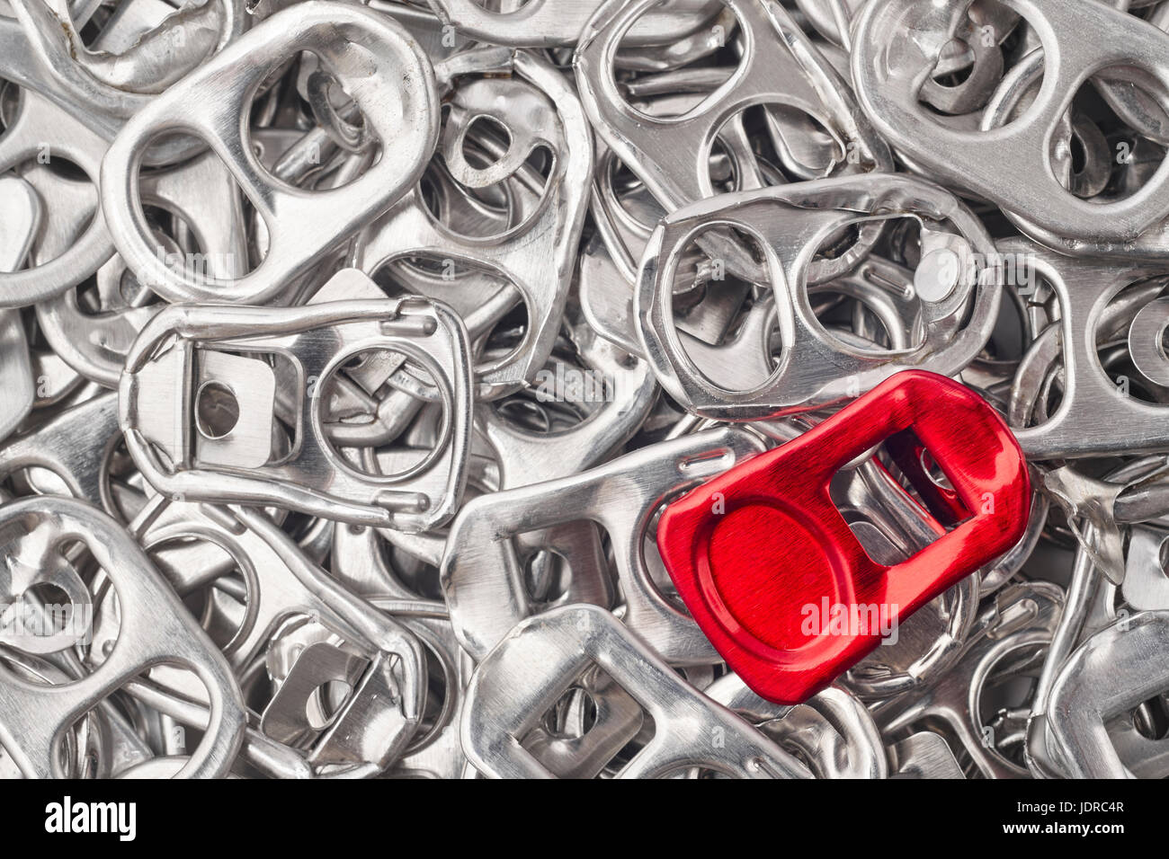 Recycling aluminum background with pull-tab pieces. Metallic waste. Horizontal - Stock Image