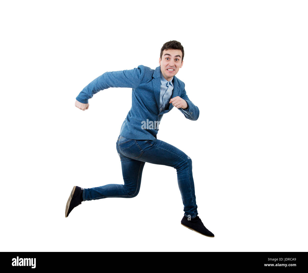 Businessman running and jumping over obstacle with a fearful expression. - Stock Image