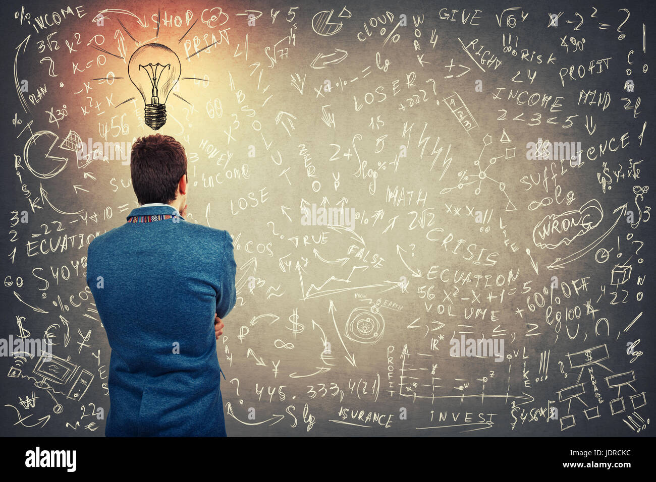 Rear view of a puzzled businessman with a lightbulb sketch above head having project ideas and business planning - Stock Image