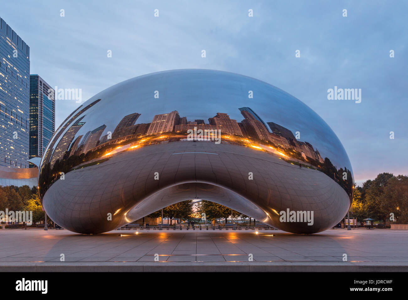 Dawn picture at Millennium Park, Chicago, showing a dark blue  sky , THE BEAN and reflections of skyscrapers. - Stock Image