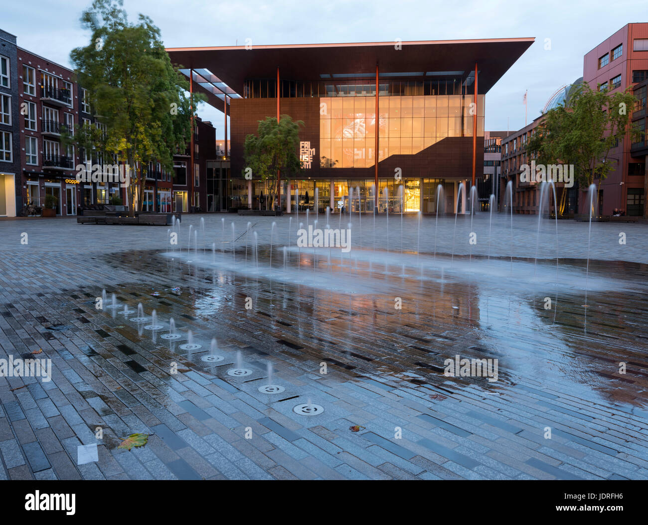 modern fries museum at dusk in center of old province capital leeuwarden of friesland in the netherlands with reflections - Stock Image