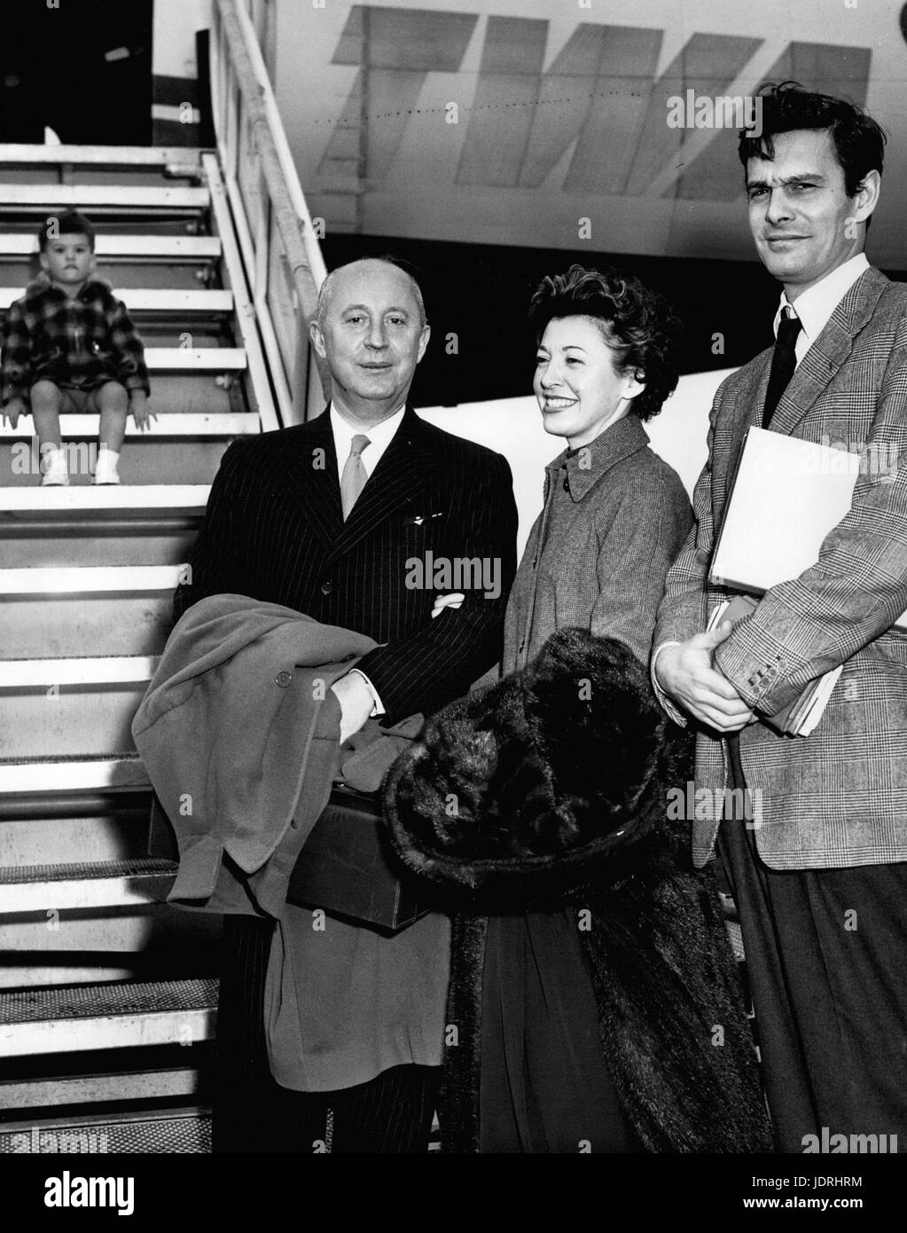 Feb. 24, 1962 - Idlewind Airport, N.Y., May 5 Actor Louis Jourdan, (right) his wife Quique, and fashion designer Stock Photo