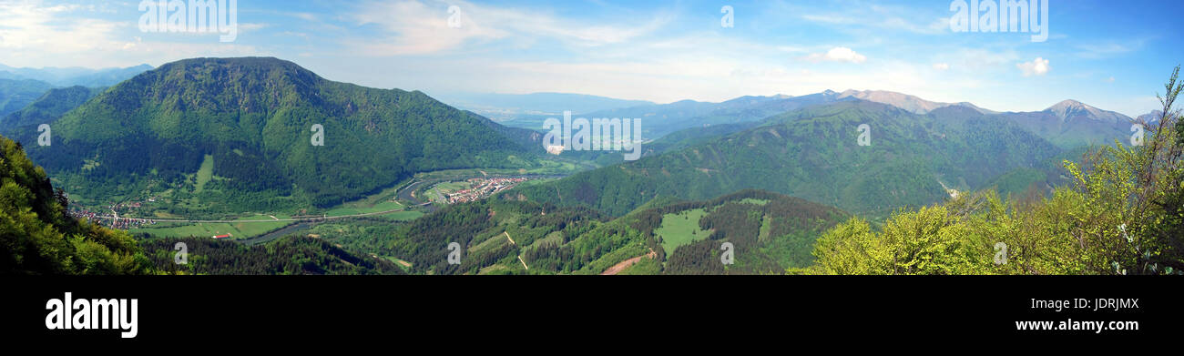 spectacular panorama with Vah river valley with few villages, Velka Fatra and Mala Fatra mountain range and blue Stock Photo
