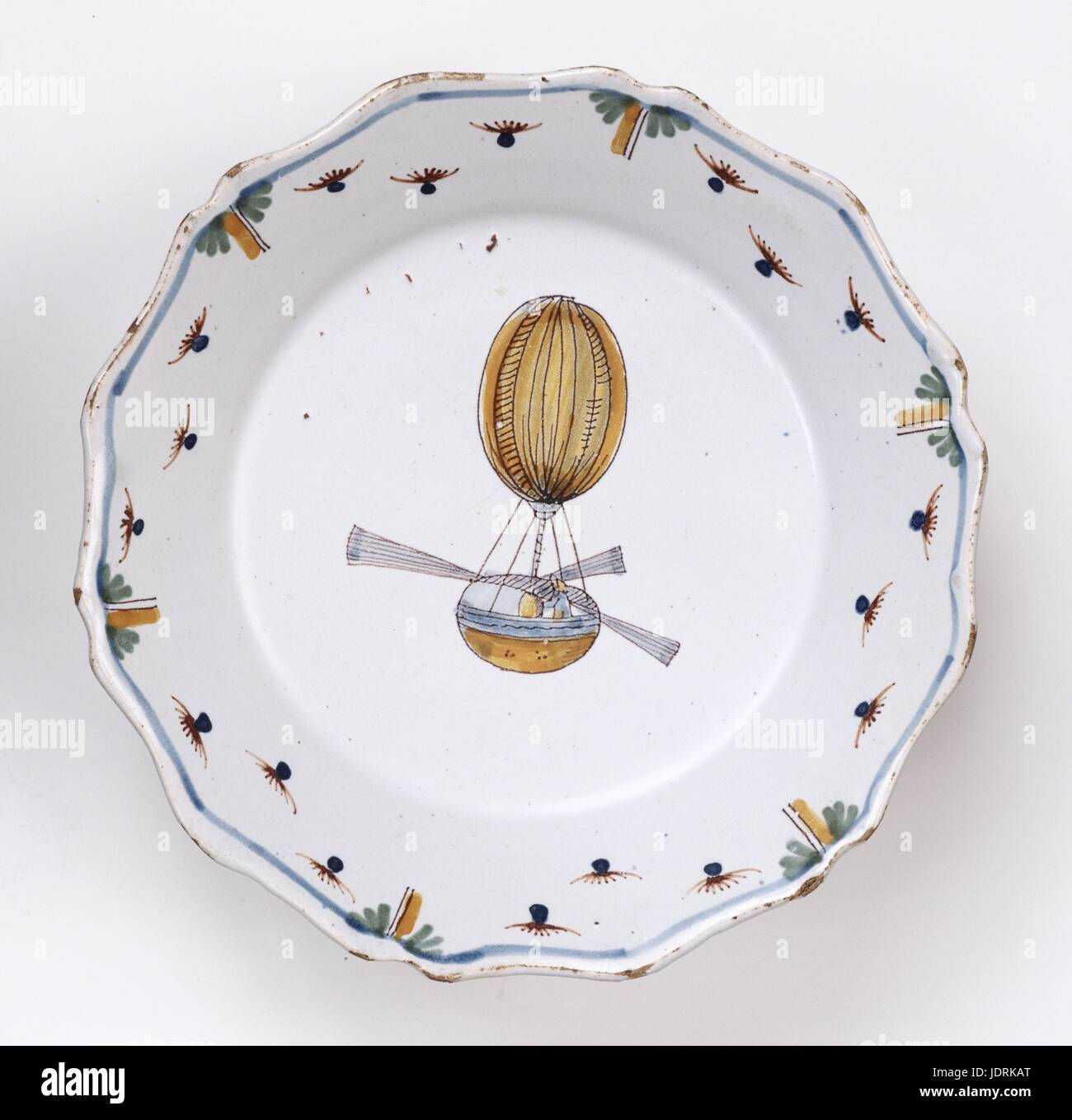 Polychrome faience plate with curved edging, Nevers  Blainville engineer's balloon  Diameter 23 cm  Muller-Quênot Stock Photo