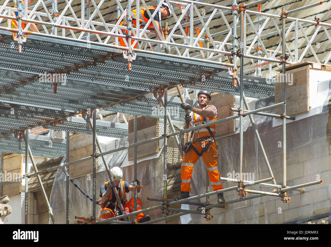 Workers can be seen building up the scaffolding around the Palace of Westminster. - Stock Image