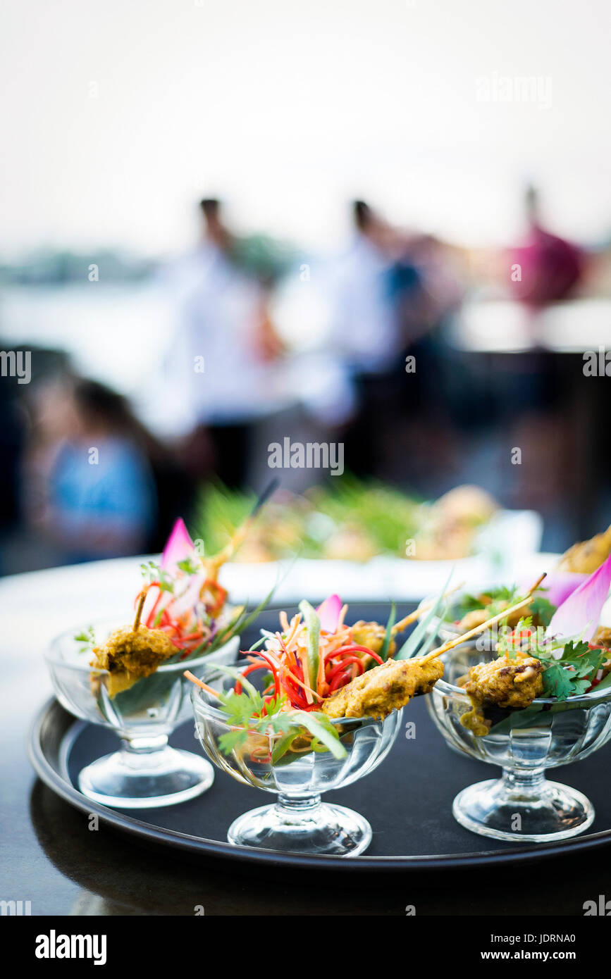 asian chicken satay gourmet snack food in modern tropical outdoor bar - Stock Image