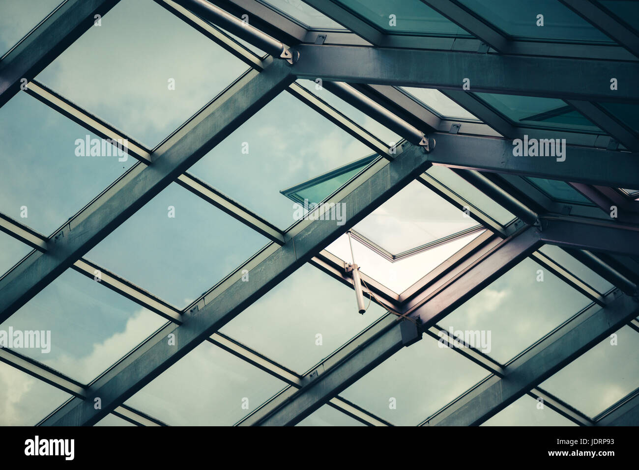 Glass skylight roof with open window, architectural feature detail - Stock Image