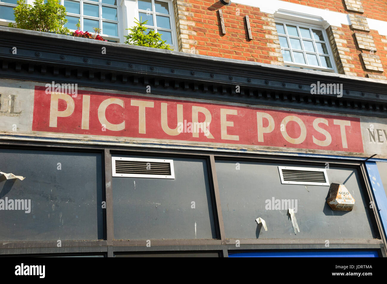 Picture post magazine mast-head logo / advert advertised on a shop which is being refurbished, so revealing the - Stock Image