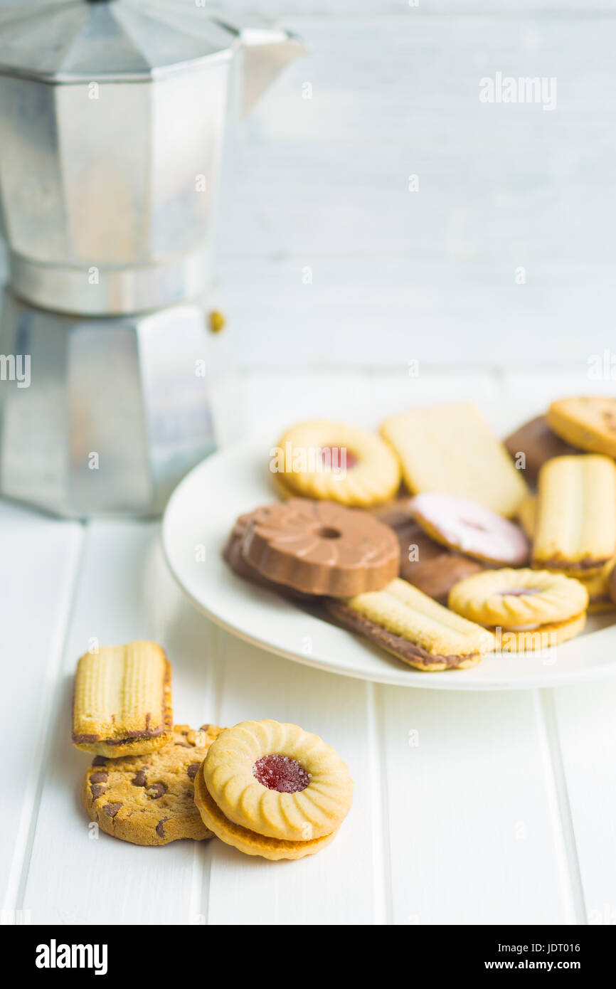 Various sweet biscuits on kitchen table. - Stock Image