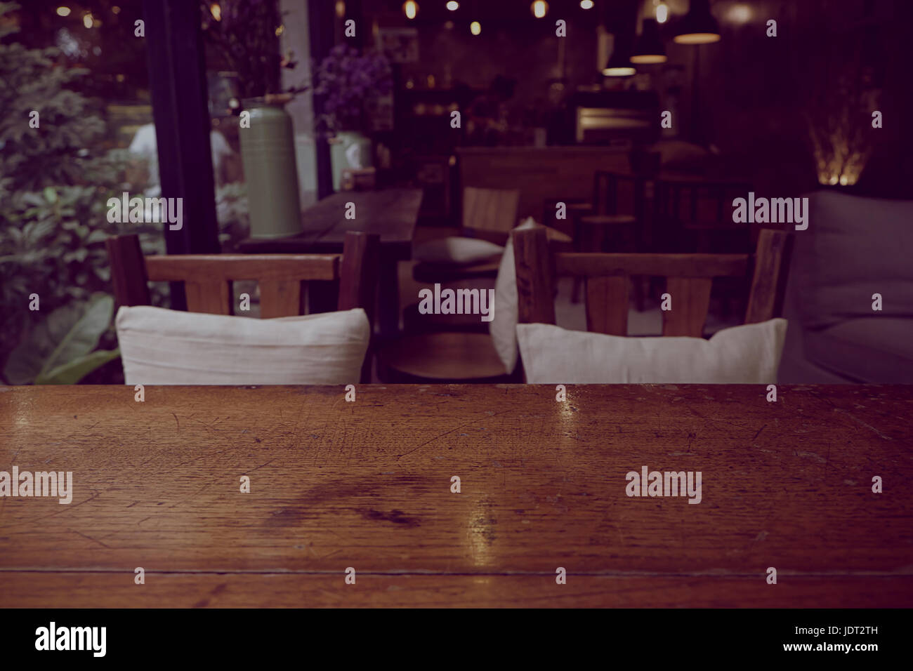 Top of empty wood table with Bar Cafe Restaurant blurred background, product display template, Business presentation - Stock Image