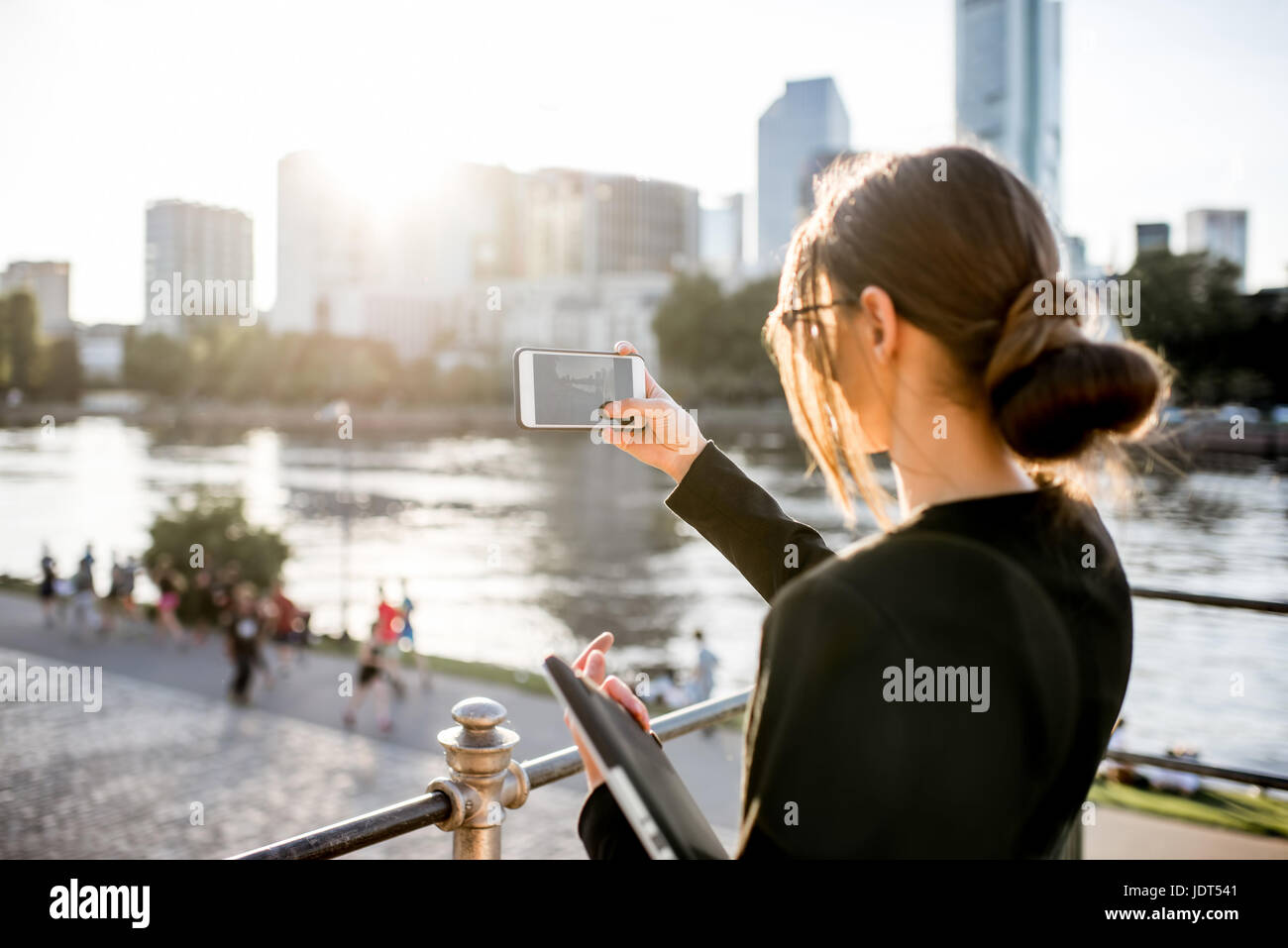 Businesswoman photographing Frankfurt cityscape Stock Photo