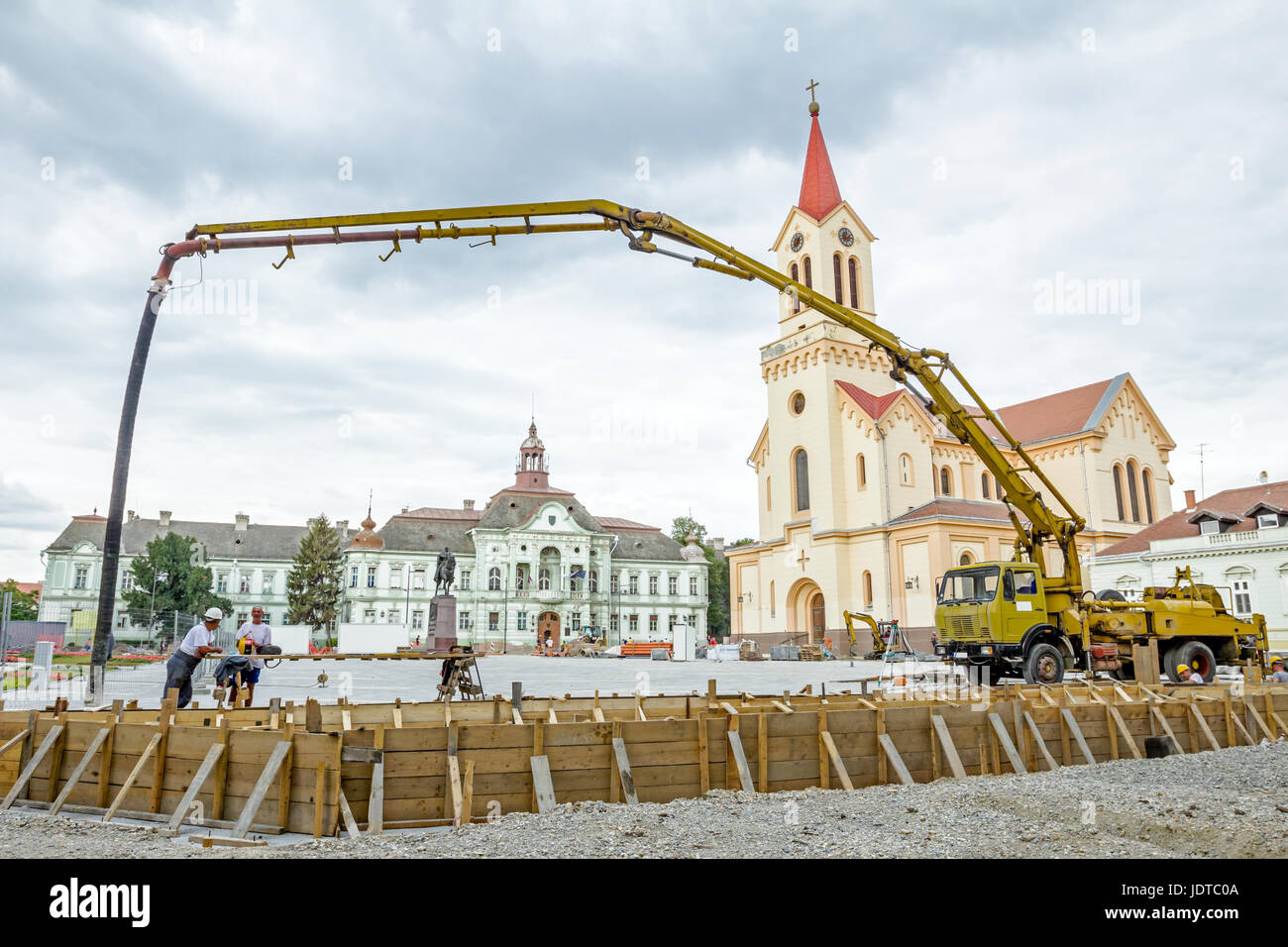 Prepared crane's arm of mechanical pump is ready for concrete transport. - Stock Image