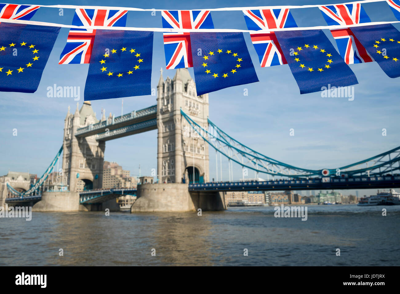 EU and UK bunting flags flying in front of the London, England skyline over the River Thames at Tower Bridge - Stock Image