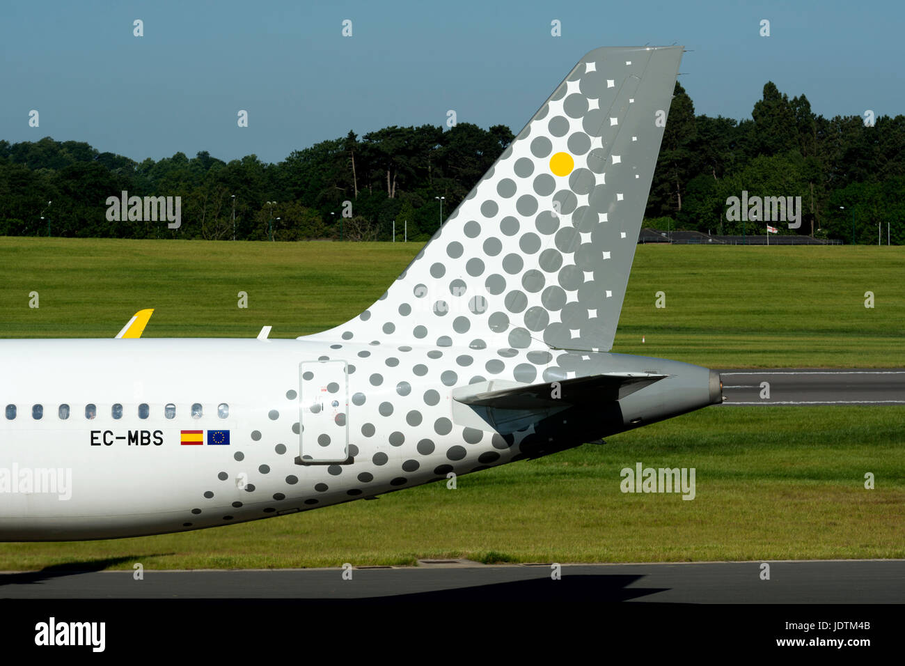 Vueling Airbus A320 taxiing at Birmingham Airport, UK (EC-MBS) - Stock Image