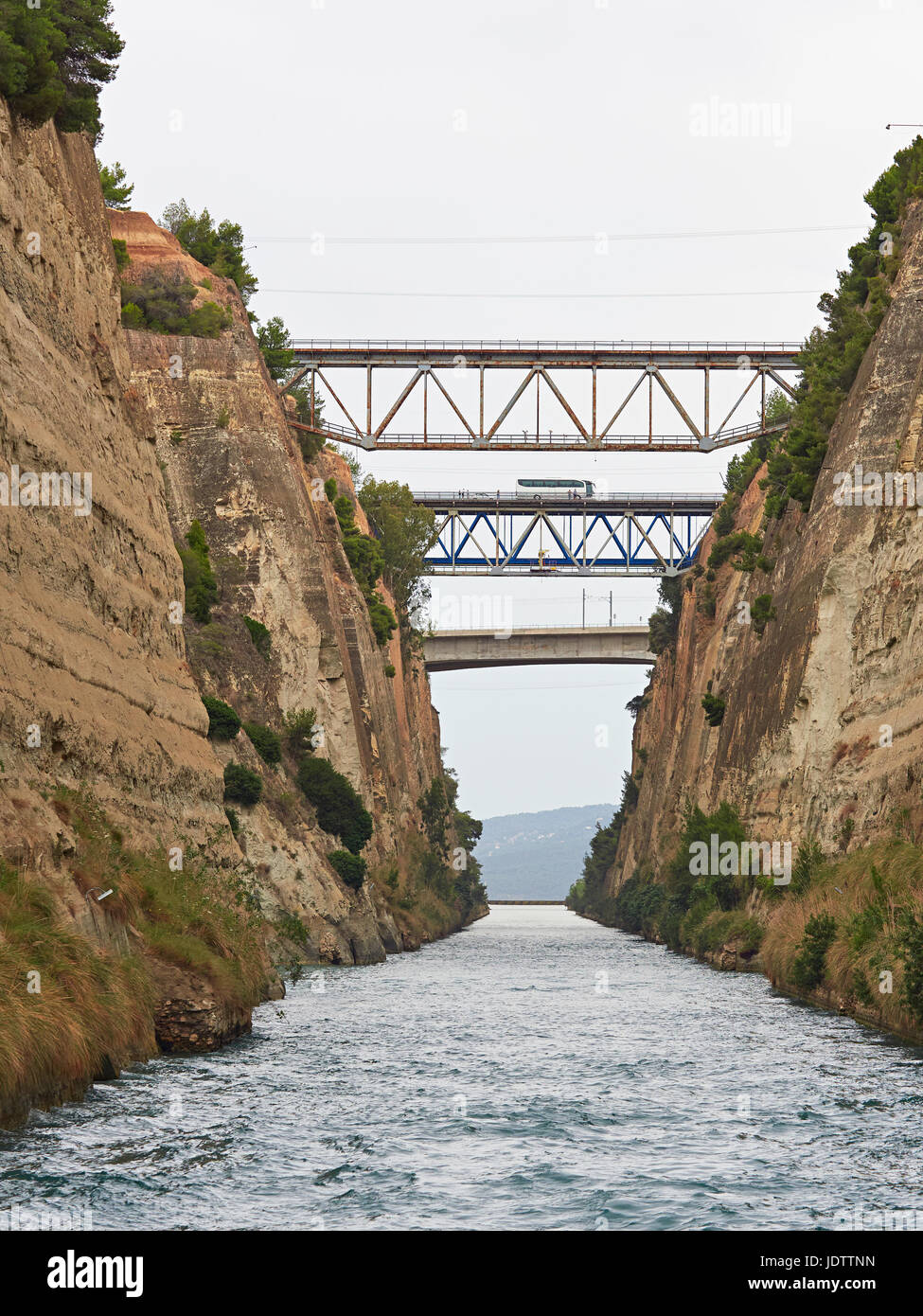 Corinth Canal connects the Gulf of Corinth with the Aegean and cuts through the land that separates the Peloponnese - Stock Image