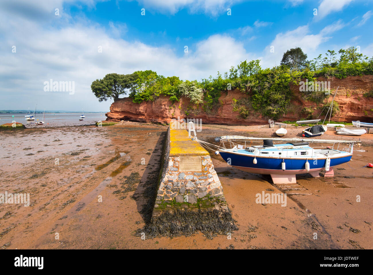 The Boat Shelter, forming part of the harbour at Lympstone, Devon.  The Triassic Red Sandstone cliff is known as - Stock Image