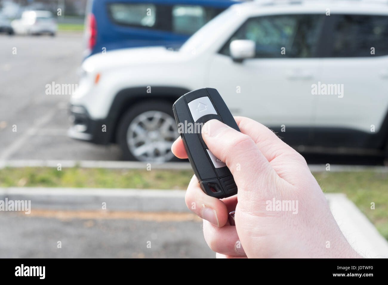 Hand holding a car alarm key with anti-theft - Stock Image