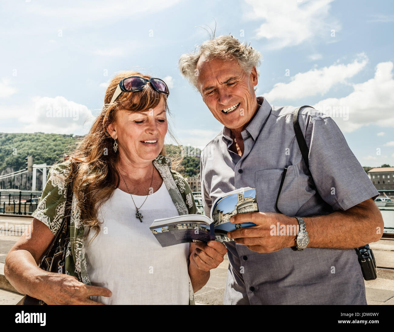 Older couple reading travel guide Stock Photo