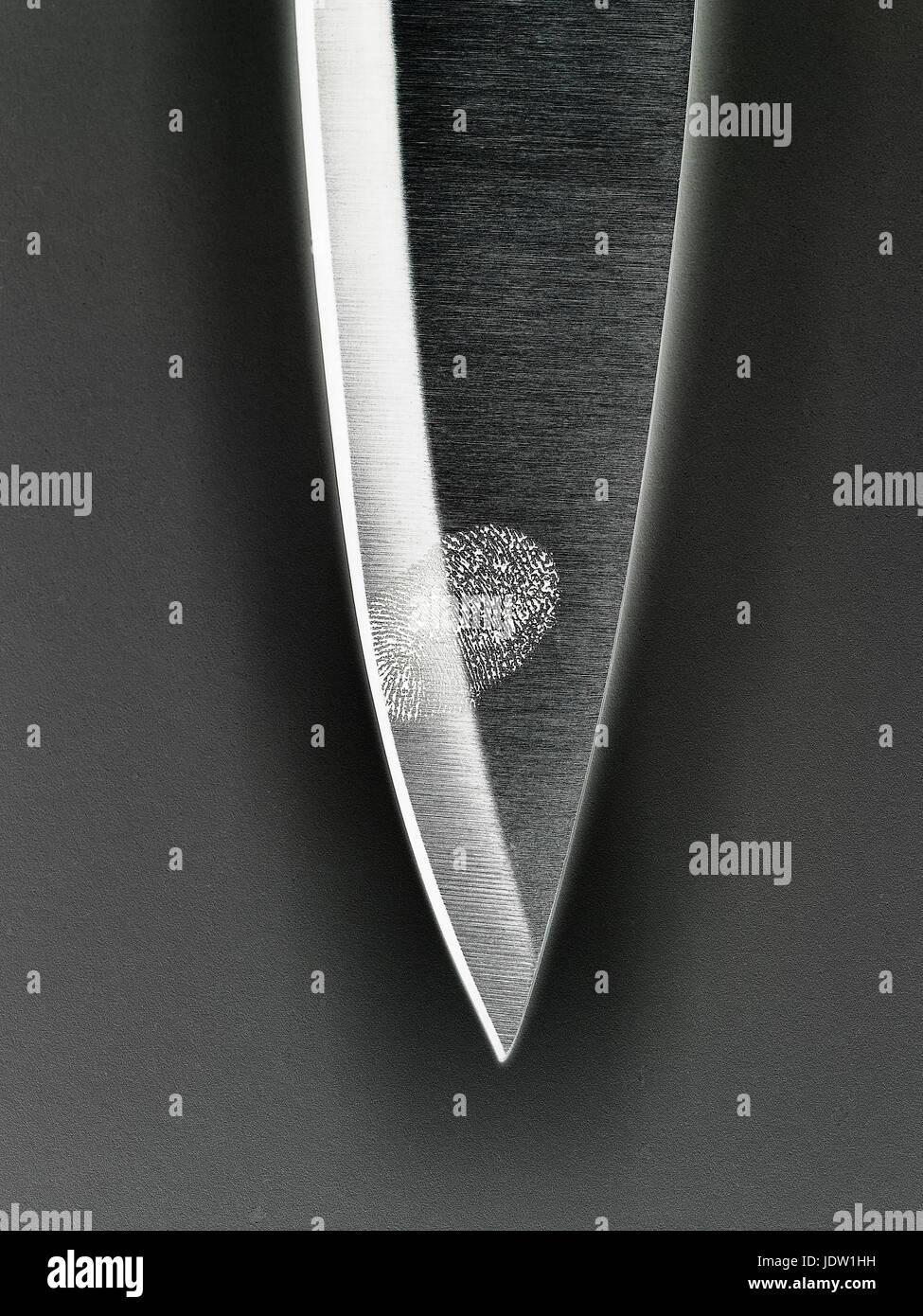 Close up of fingerprint on knife blade - Stock Image