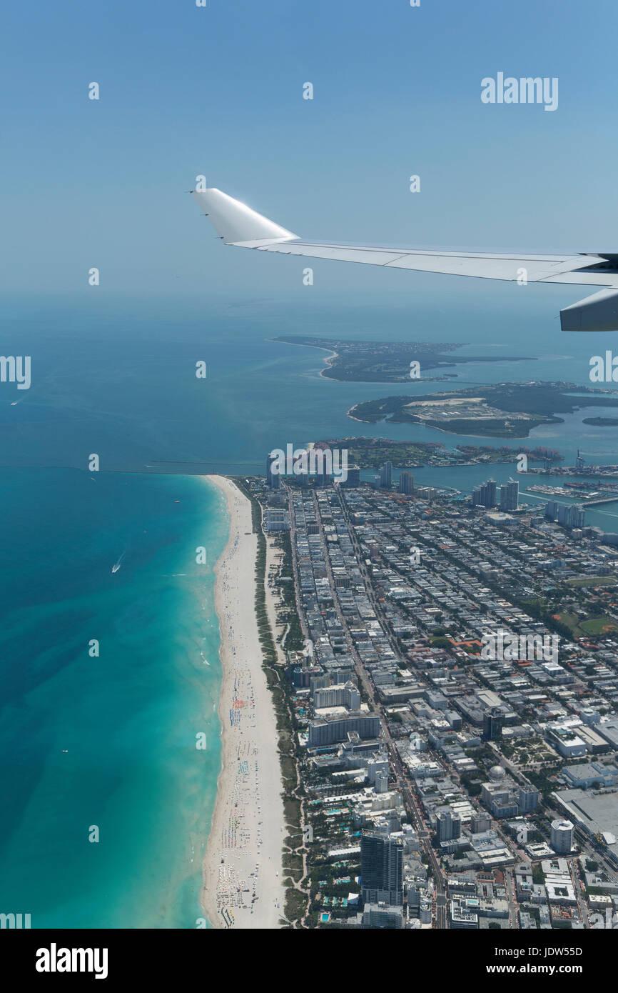 Airplane wing over Miami Beach, Florida, USA - Stock Image