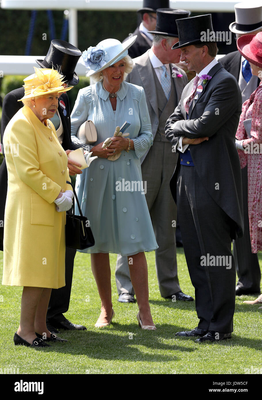 Her Majesty The Queen (left), The Duchess of Cornwall (centre) and Johnny Weatherby during day two of Royal Ascot - Stock Image