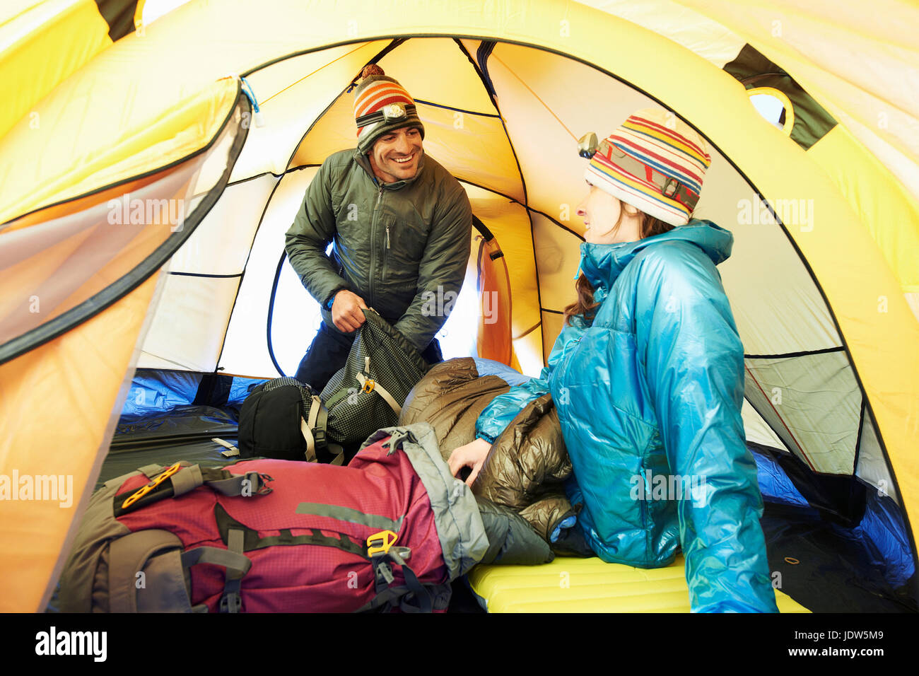 Mid adult couple in tent - Stock Image