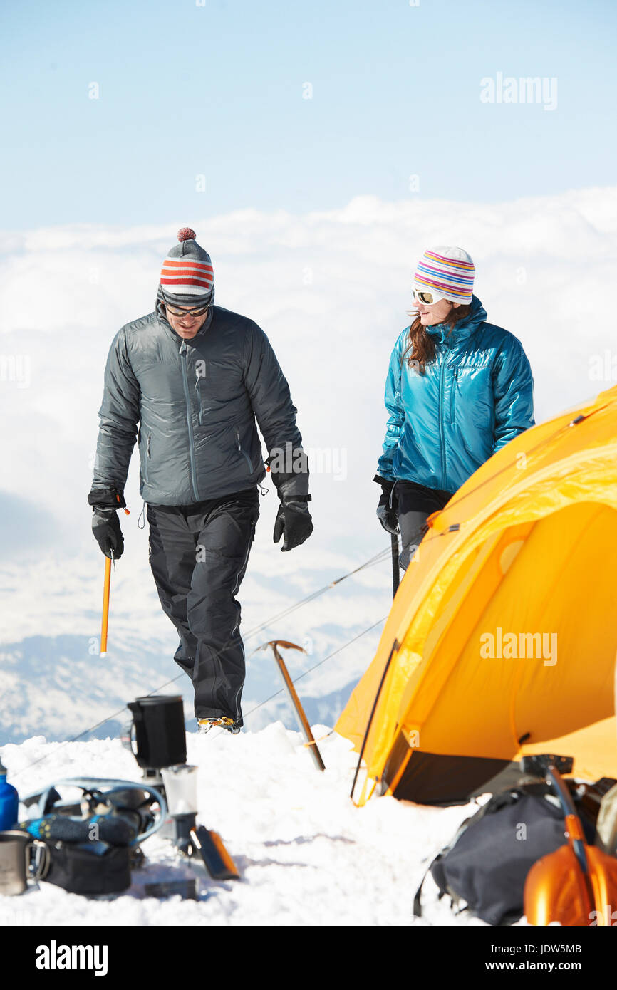Mid adult couple by tent, Chamonix, France - Stock Image