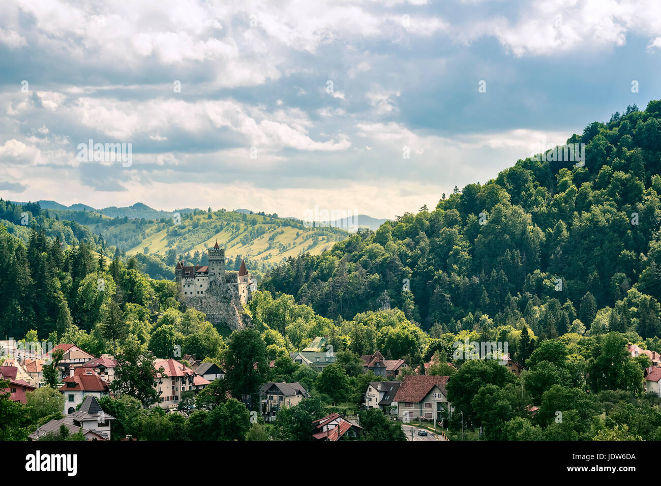 Countryside overlook view of houses and castle over the hills in the summer Stock Photo