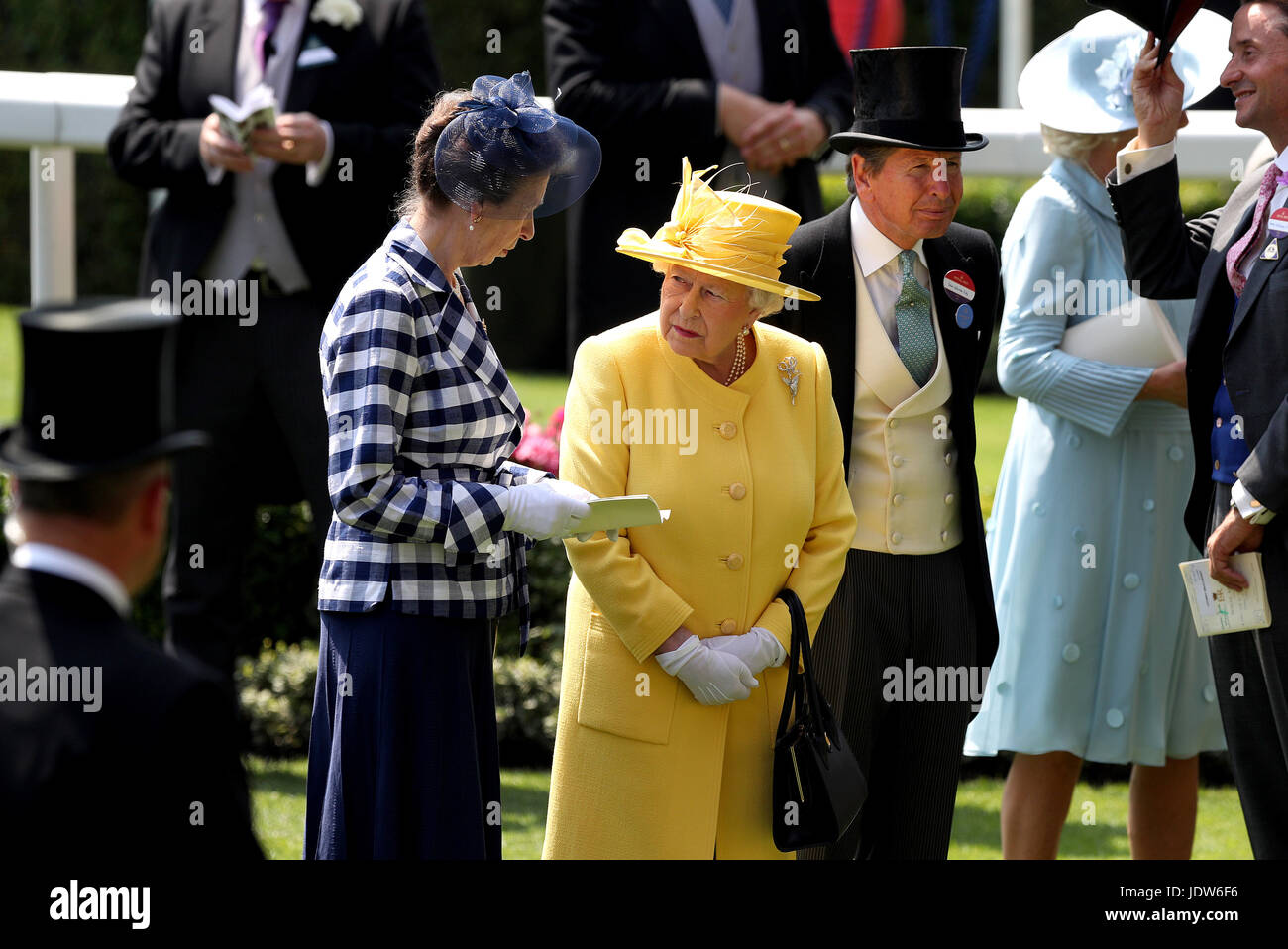 Her Majesty The Queen (centre) and Anne, Princess Royal (left) in the parade ring during day two of Royal Ascot Stock Photo