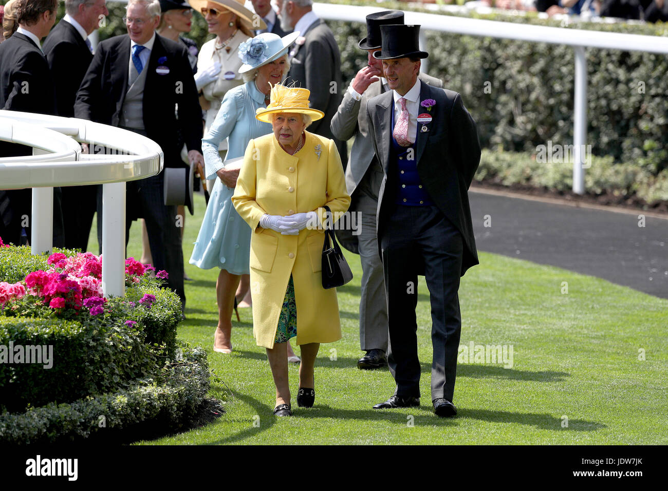 Her Majesty The Queen (left) and Johnny Weatherby (right) in the parade ring during day two of Royal Ascot at Ascot Stock Photo