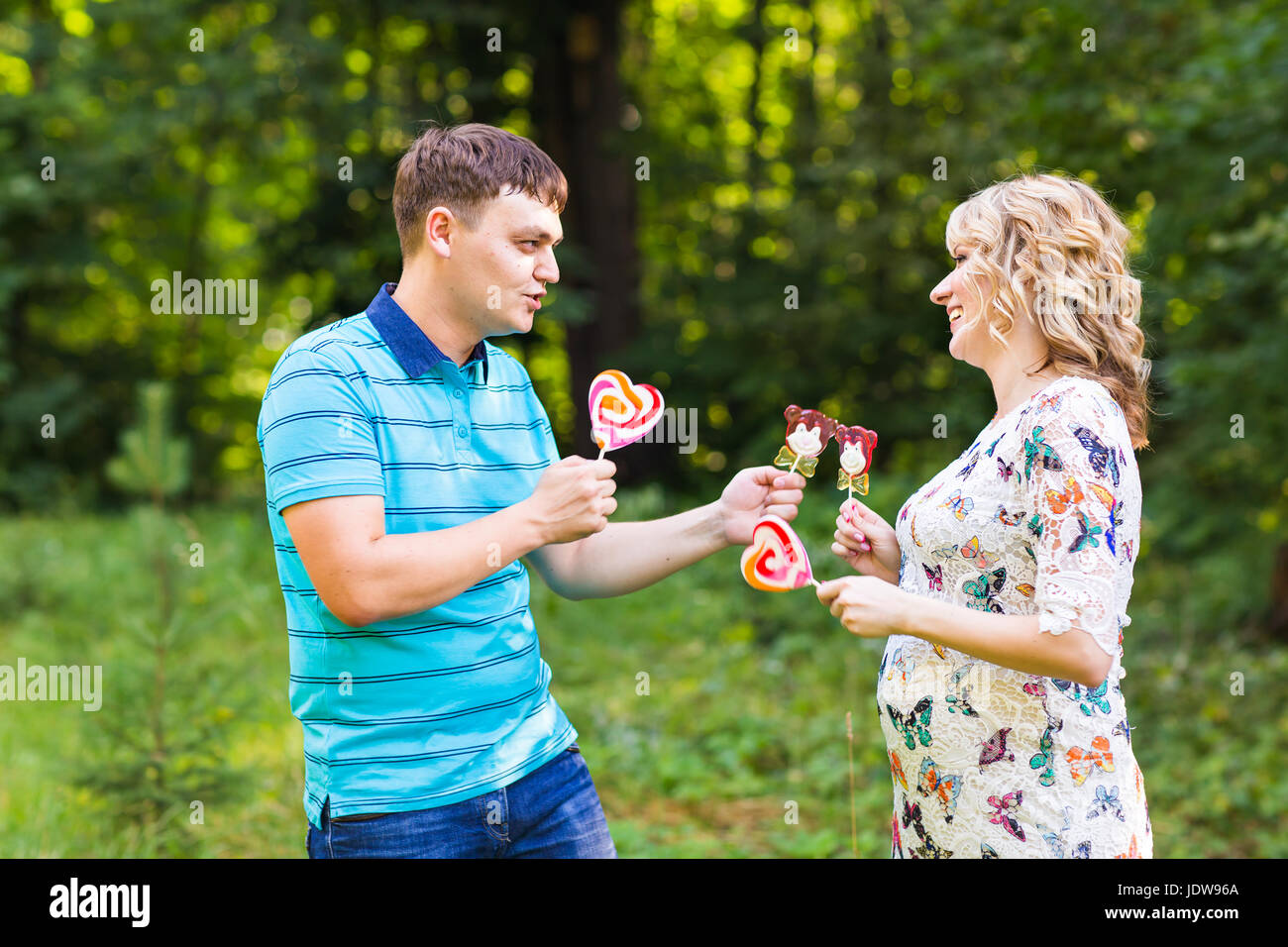 Happy beautiful pregnant woman and her husband Stock Photo