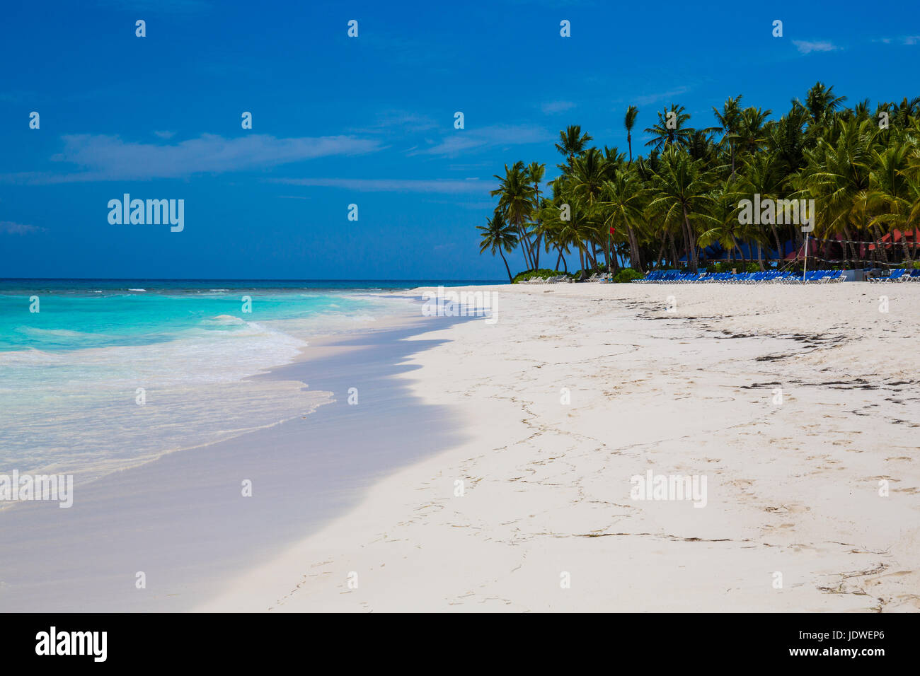 Caribbean Sea and an island with palm trees and white sand - Stock Image