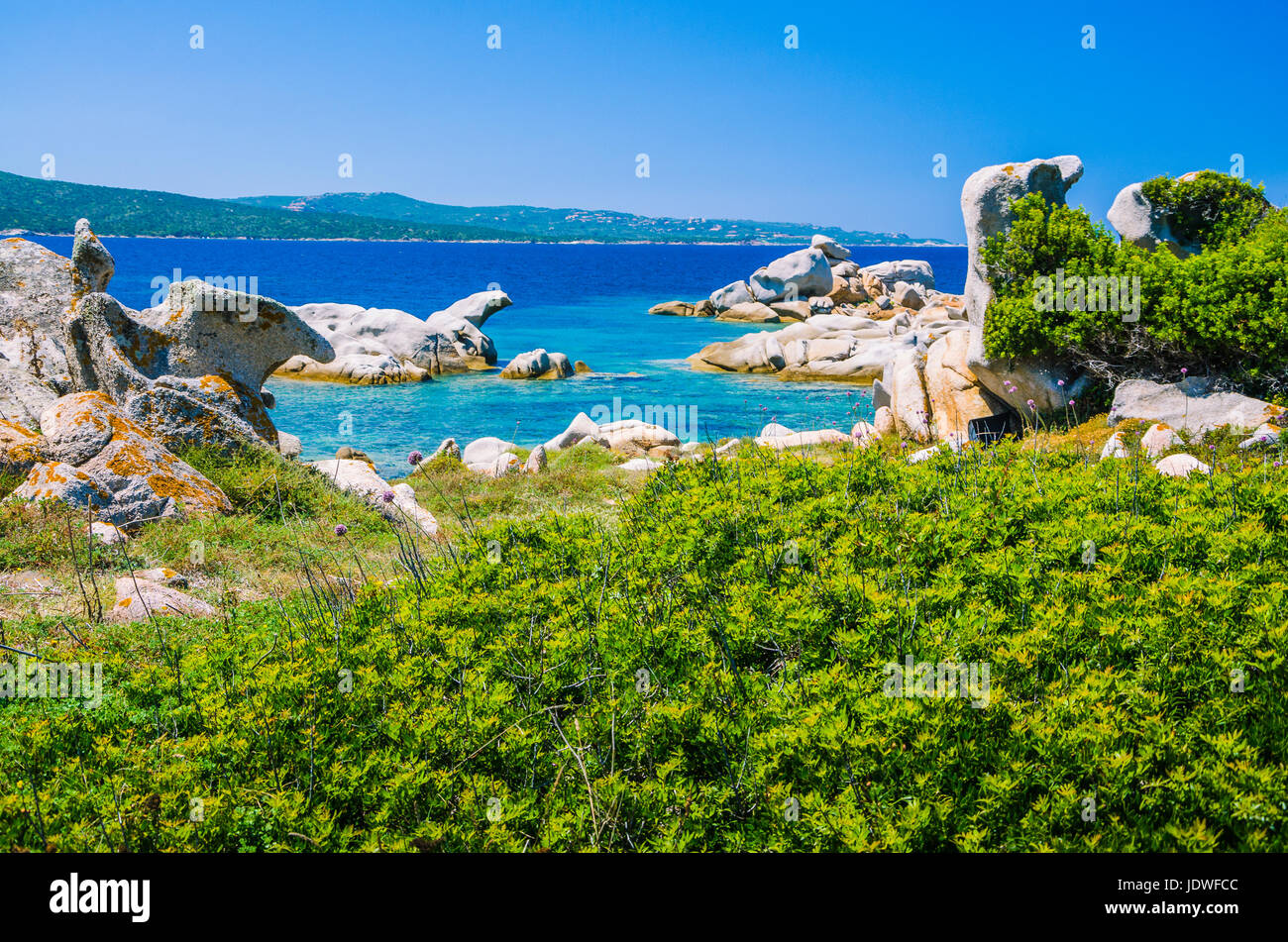 Costline with granite rocks and azure water near Porto Pollo, Sardinia, Italy - Stock Image
