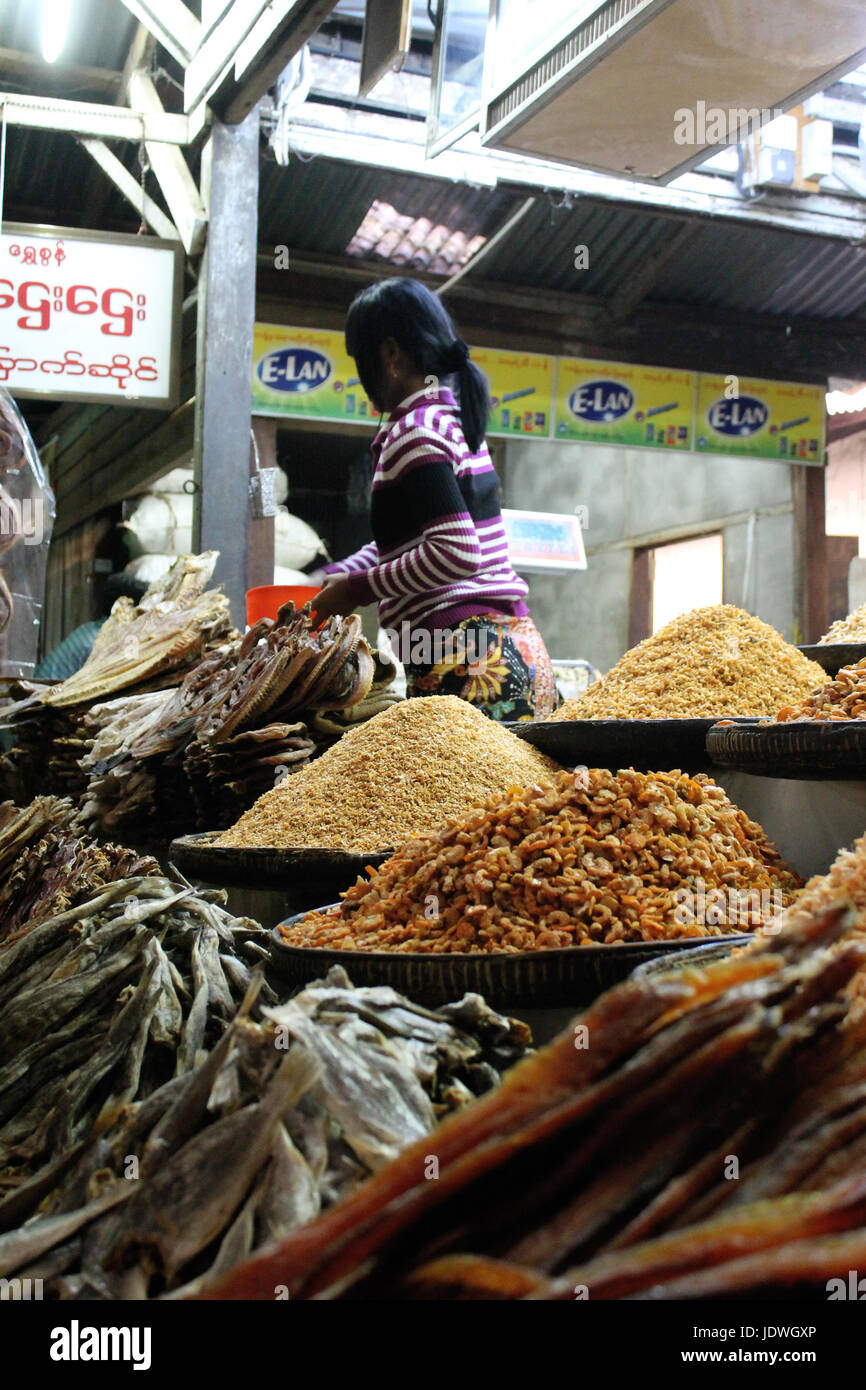 Zegyo Market/Mandalay - Myanmar January 22, 2016: Stall at the indoor section of Zegyo Market selling dried fish - Stock Image