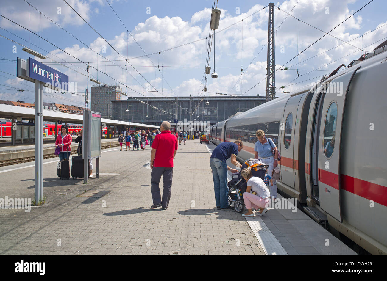 Passengers on platform after alighting from train, Munich main railway station, Germany - Stock Image