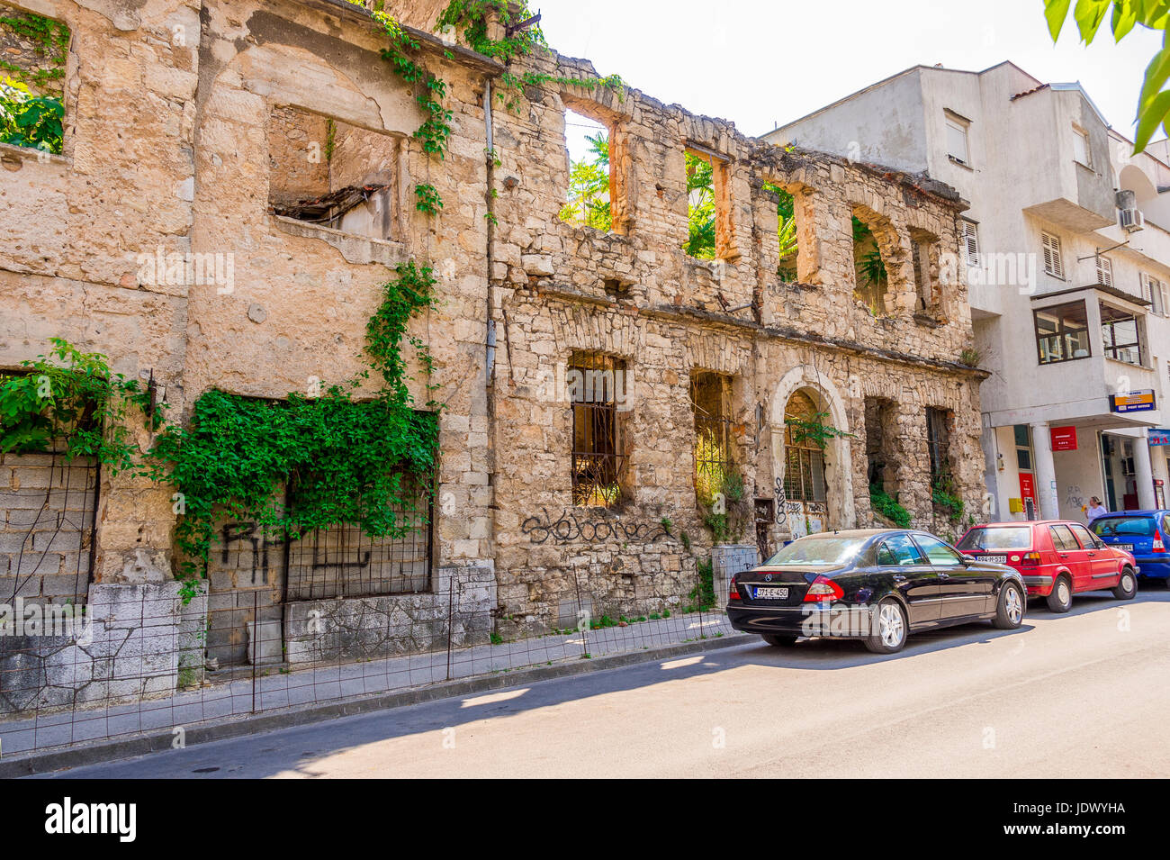 Mostar still shows evidence of the Homeland war with many buildings destroyed - Stock Image