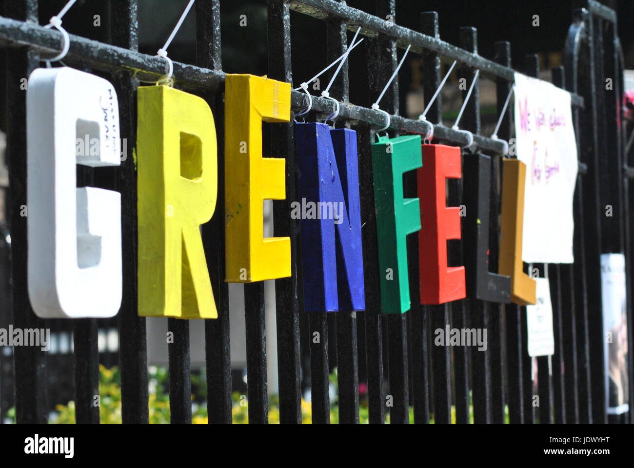 Grenfell  in Memorial Letters on Fence (at the boundary of where the building stands) The People Remember - Stock Image