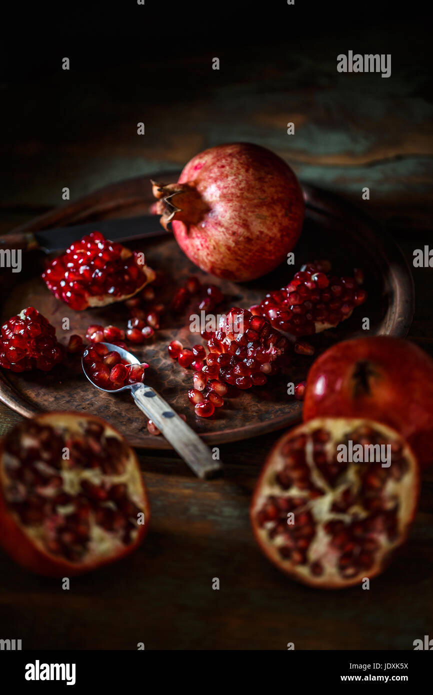Healthy food concept, juicy pomegranates on vintage background Stock Photo