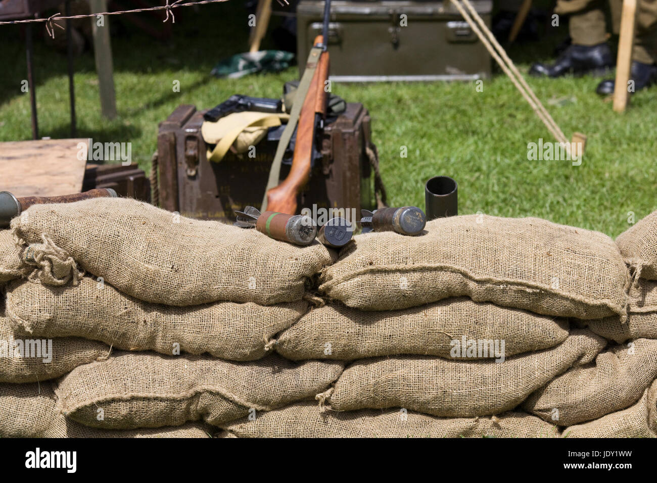 Sandbag Bunker with barbed wire with a riffle and grenades - Stock Image