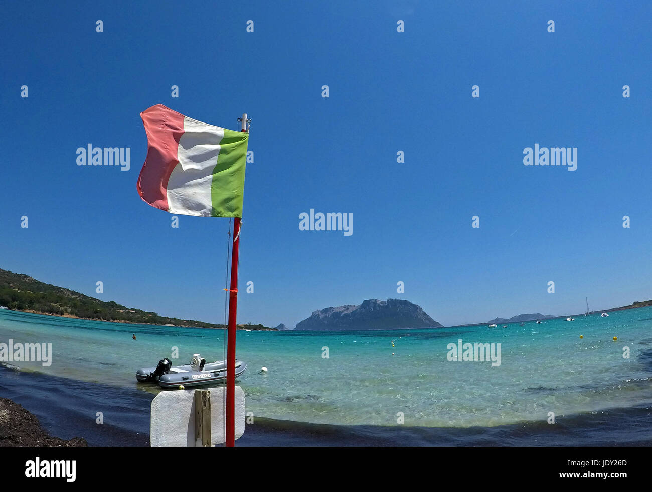Olbia, Sardinia. Porto Istana beach and the Tavolara Island in the background - Stock Image