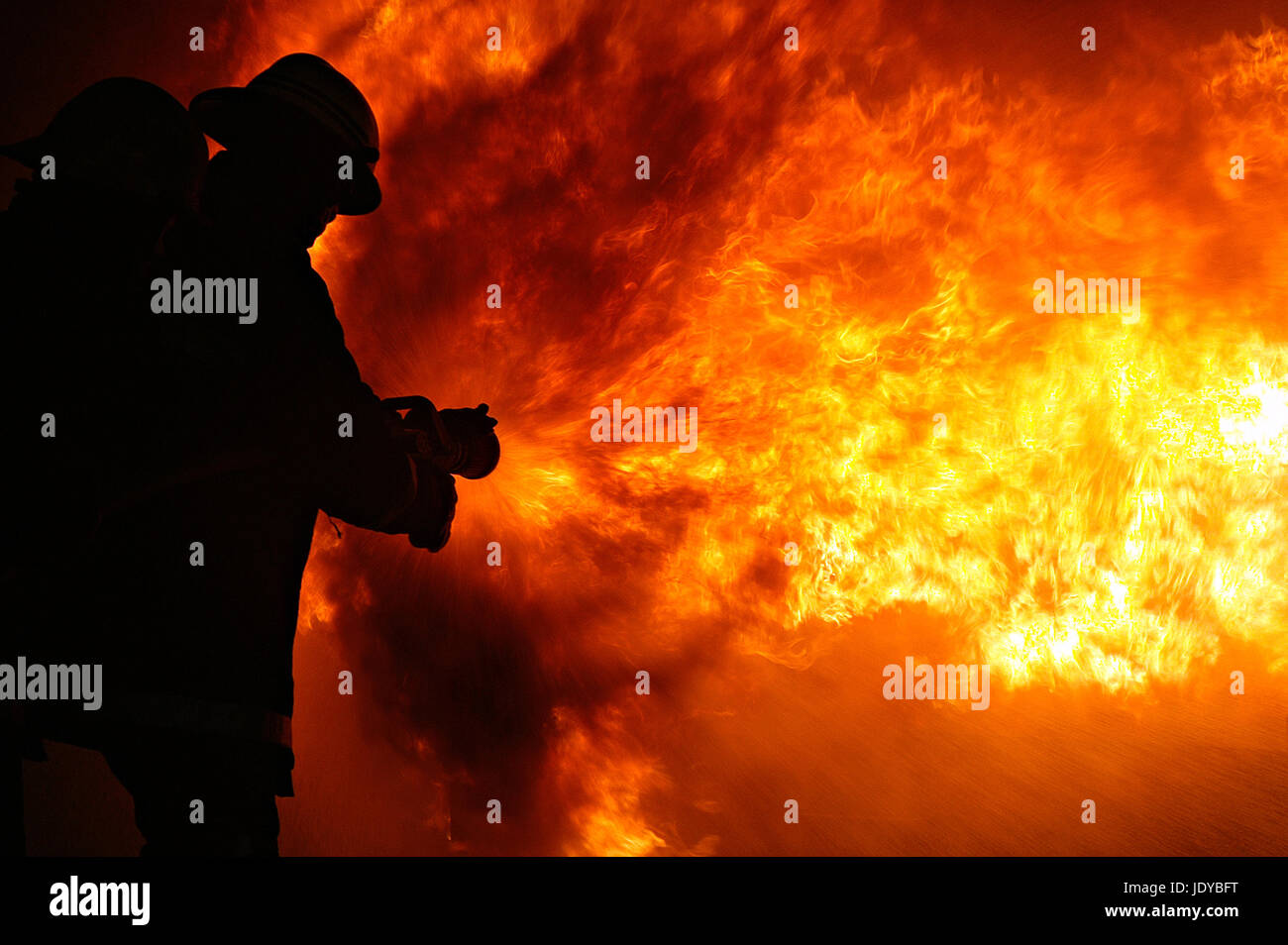 fire fighters fighting high rise flat fire, inferno, Grenfell tower, London - Stock Image