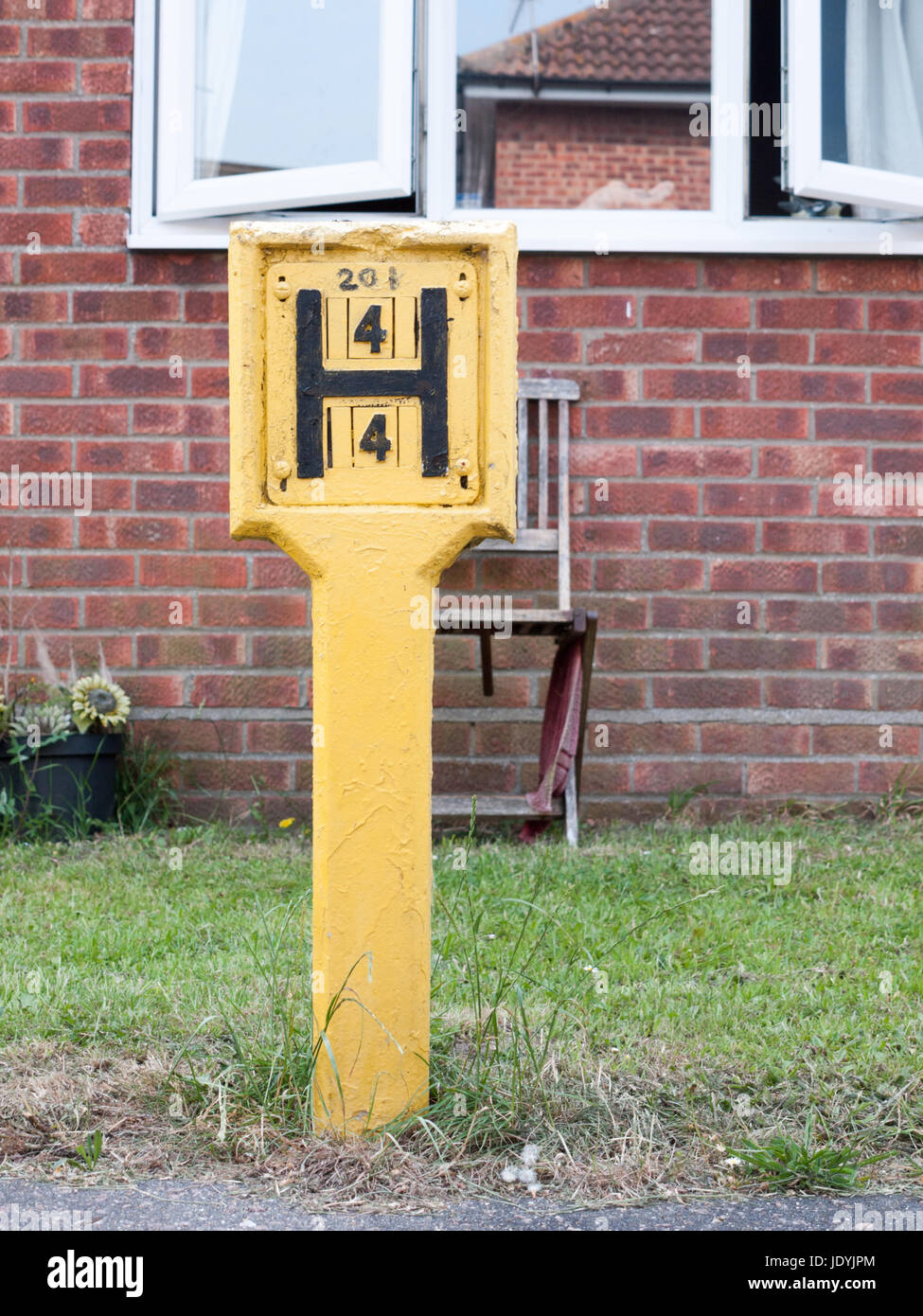 yellow h sign outside hydrant fire safety - Stock Image
