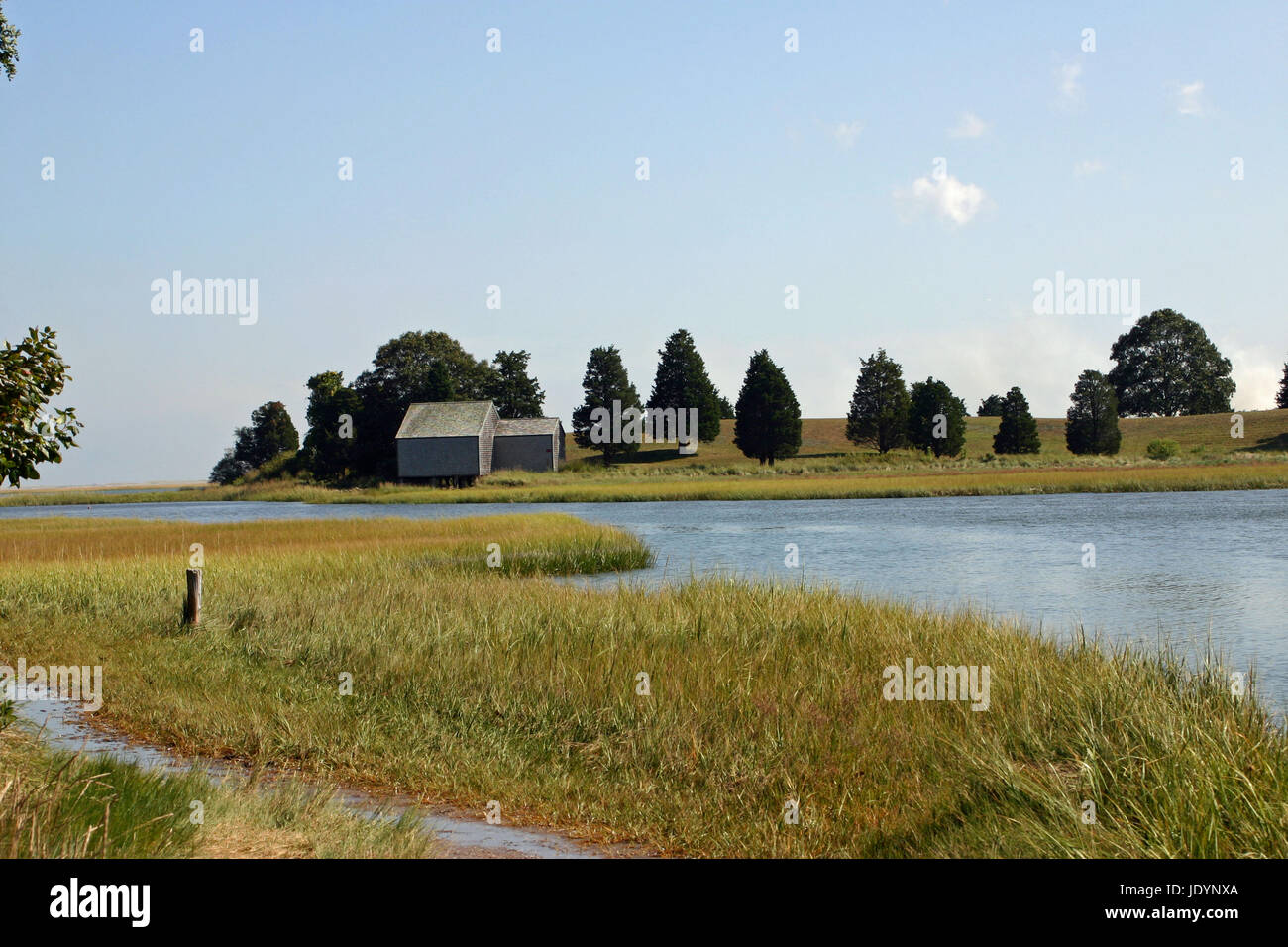 A weathered, gray-shingled shack on Salt Pond at the Cape Cod National Seashore, Eastham, Massachusetts, viewed Stock Photo