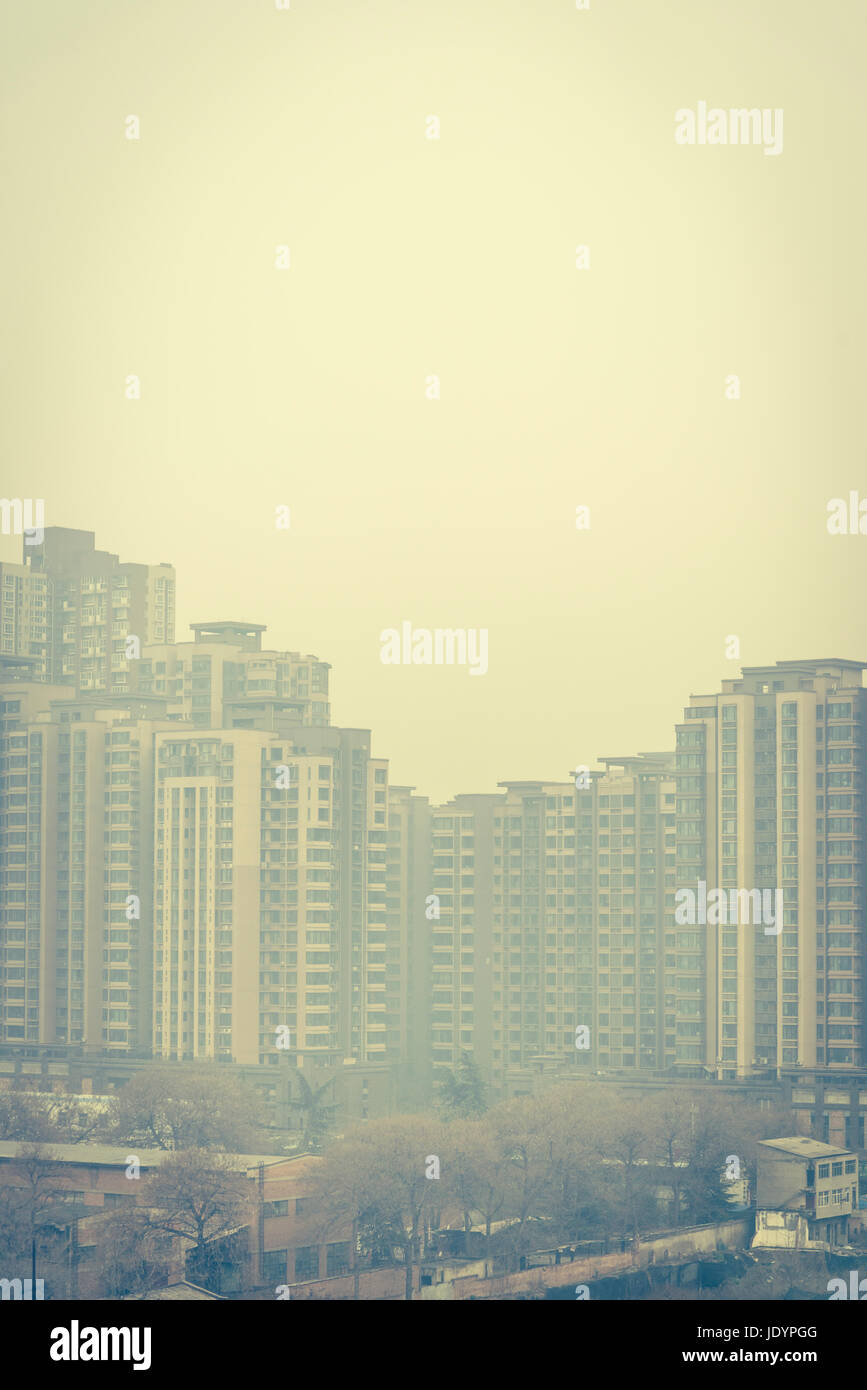 Residential suburb of high rise tower blocks in air pollution, Xian, Shaanxi province, China - Stock Image