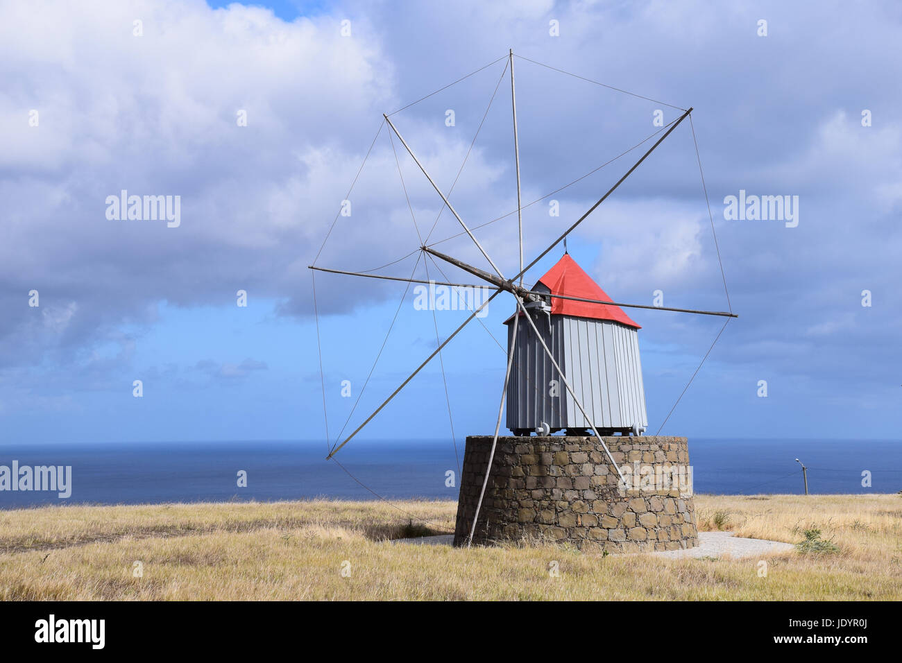 Traditional windmills that once produced flour for ships on the way to America found on the hillside in Porto Santo - Stock Image