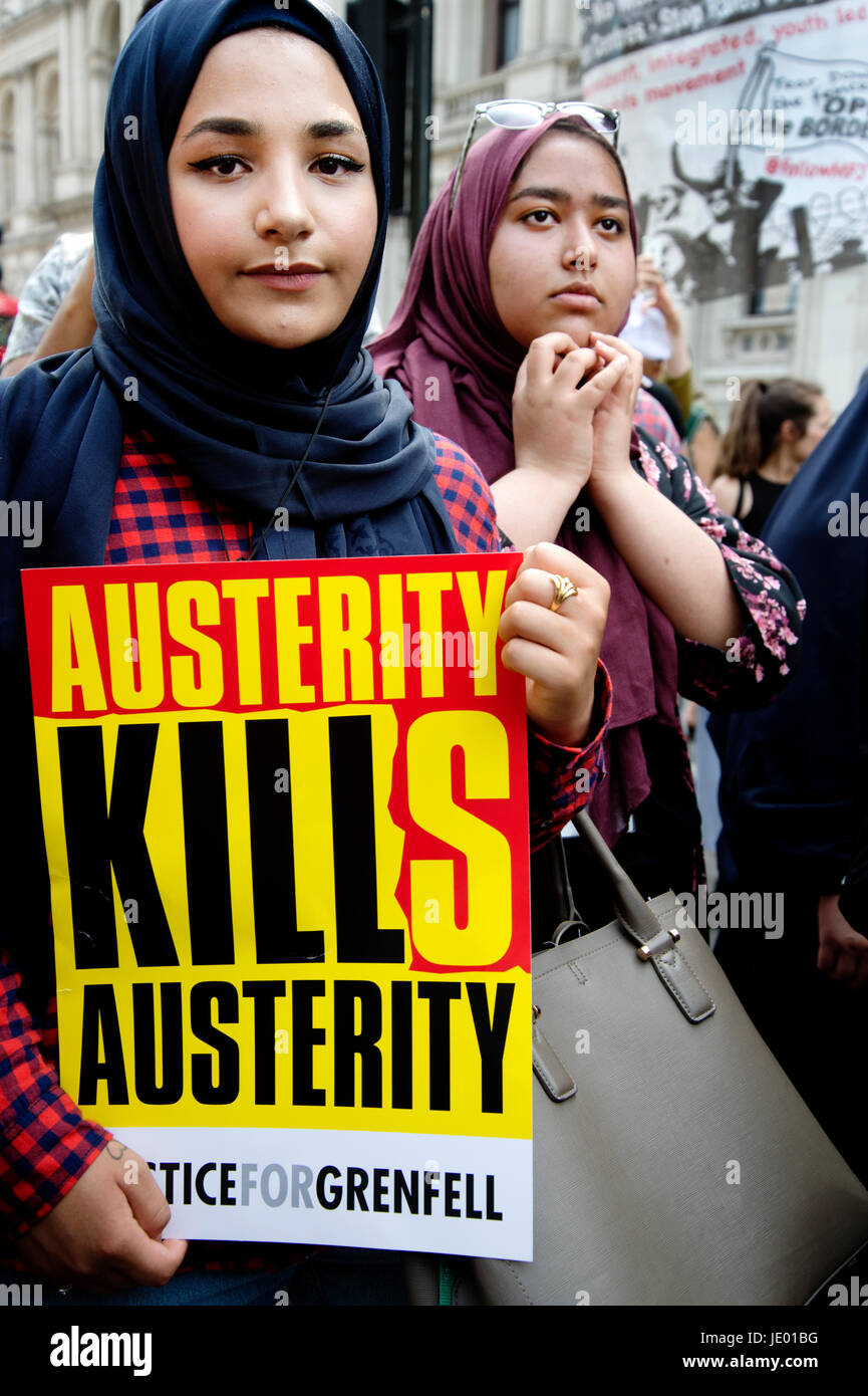 London, UK. 21st June, 2017. Day of rage protest after the fire at Grenfell House, West London. A woman holds a Stock Photo