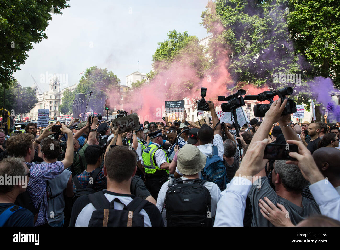 London, UK. 21st June, 2017. Smoke grenades outside Downing Street during a 'Day of Rage' march by activists from Stock Photo
