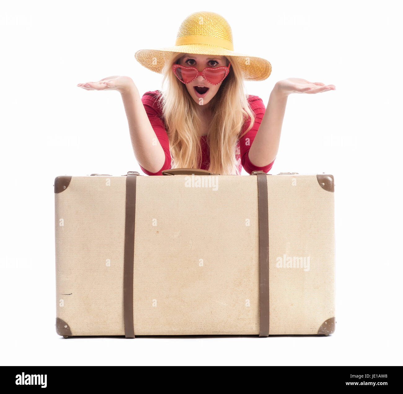astonished woman with suitcase - Stock Image